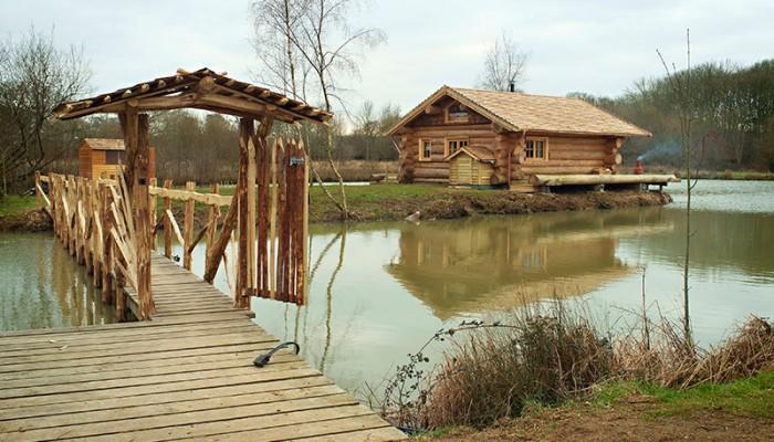 Luxury Log Cabin - Best log cabin exterior with footbridge
